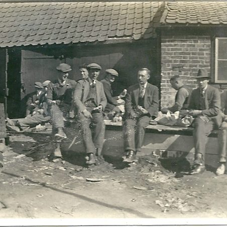 Lunch break, the open doors are the entrance to the skittle alley, apparently this had not been used for some time.  Joan English remembers that a few years later than this photograph, the building was in a state of disrepair and was used as a store.   Joan English