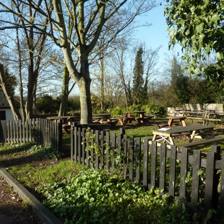The beer garden at the rear of the pub, where the landlord grew his vegetables and fruit trees grew along the church wall. Dec 2011   Margaret March