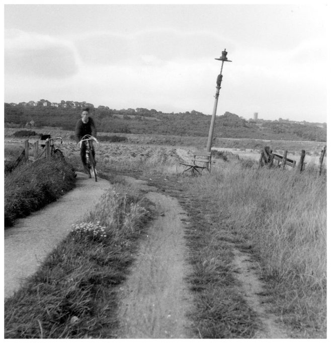 Bill on his bike, with Benfleet Downs in the background. | Janet Hayward