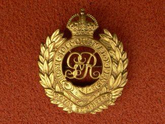 11. Cap Badge.