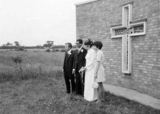 Ann Oliffs wedding with her sister Yvonne showing the fields at the back of the church.