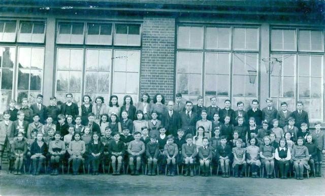 South Benfleet County Junior School 1947.  Back row from left to right, 3rd Michael French, 6th Janet Lazell, 7th Hilda Nelson, 8th Ruth Edwards, far right ? Jiggins.  Centre row Male adult with dark hair Mr Wallace woodwork teacher, apparently he had a size 11 slipper when required for naughty boys, right of him Joan Baker. | From the collection of Miss Bass, now Mrs Williams