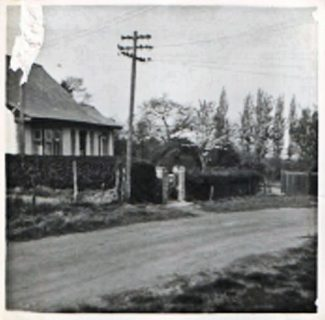 My home in 1953, just before the bend and a small portion of the allotments is visible in the bottom left. It must have been a large plot as there was a nettle overgrown tennis court and an orchard.   John Garnham
