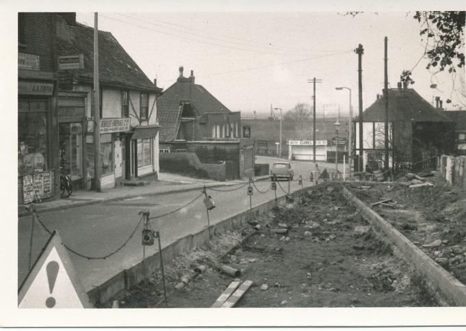 Shops backing on to graveyard demolished