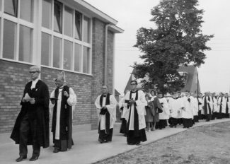 Procession into church for the dedication, Dawn White in front of Ina Osborne with Stan Osborne behind.