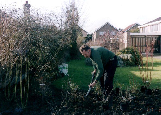 John  Grimwood working in the church garden.