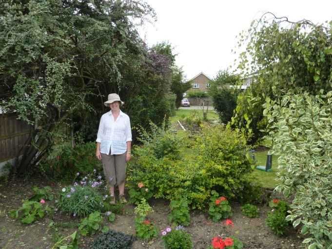 Sue Benton in front garden.