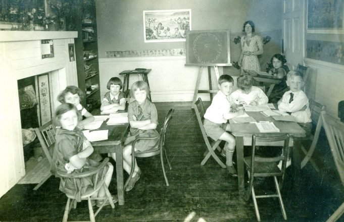 A class photo showing Miss Steggles and seated at the desk next to the teacher, Audrey Martin. | Julie Summers
