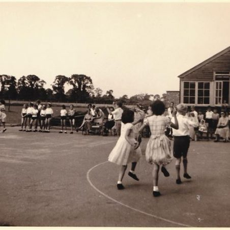 Children in the playground at New Thundersley Primary school, 1950's.  This is one of the three wooden classrooms. | Doreen Colvin (Nee Batchford)