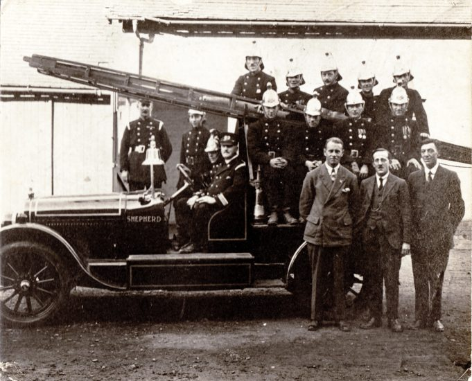 The volunteers & sponsors. Here we see a group of local dignitaries proudly standing in front of the new engine. | Essex Fire Museum