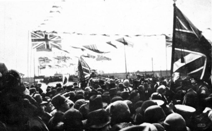 Crowds and flags just before opening of the bridge | From the Norman M. Chisman collection