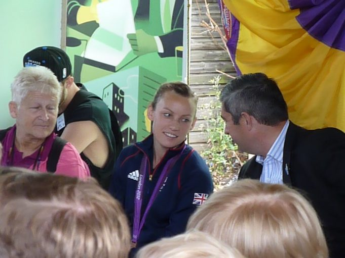 Chloe Rogers speaking with County Councillor Steve Castle while an Essex Ambassador looks on. | Phil Coley