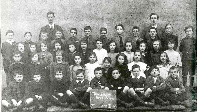 Class II - Taken in 1921 the school's first year. Standing back left - Headmaster Colonel Bransdon and back right - teacher Mr Williams. | Thundersley Primary School