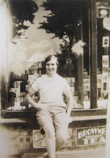 My mother outside the stores in 1927. Note the Browne's Tea advertisement. | © J. Wernham