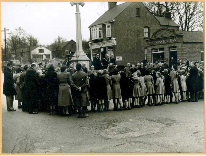 No.14 on the map - Celebrations of February 1952 for the Accession of Her Majesty Queen Elizabeth II taken at The War Memorial. In the background The Clock House Cafe and Westminster Bank | Castle Point Council