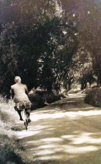 A member of the family cycling down Bread & Cheese Hill - possibly Bernard Cooper | Pamela-Jeanetta Bird Gaines
