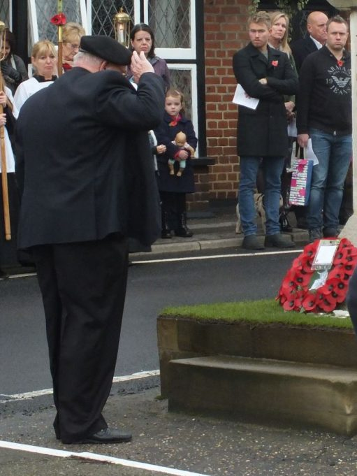 An official lays a wreath. | Phil Coley
