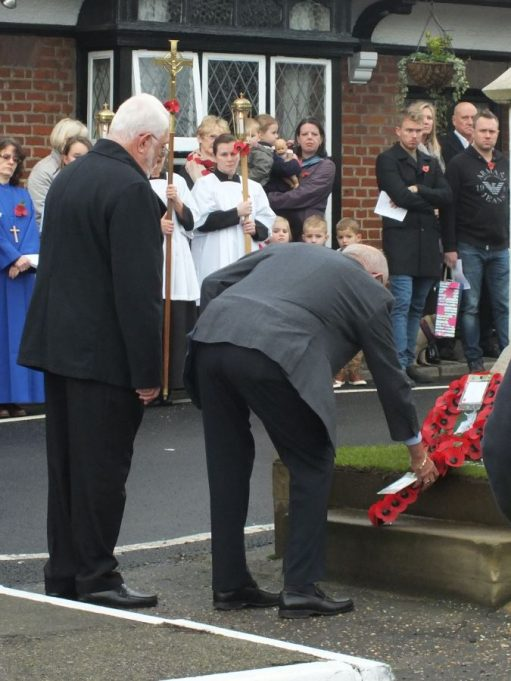 The St Mary's Church representatives lay a cross | Phil Coley