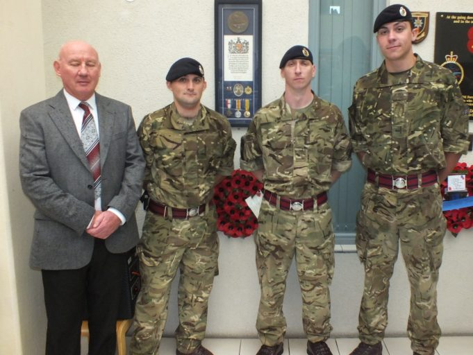 Len Hawkins who has campaigned for Sapper Ellison to be remembered with three Sappers of the Royal Engineers in front of Sapper Ellison's medals. | Phil Coley