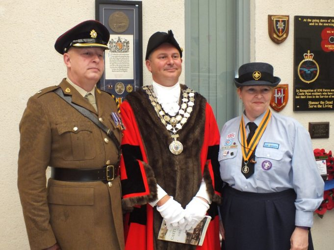 Major Billings, Mayor Cllr. Steven Cole, and Yvette, Assistant Group Scout leader 5th Canvey Island Air Scout Group in front of Sapper Ellison's medals. | Phil Coley