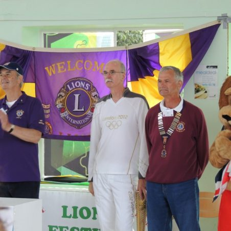 Olympic torch bearer Ian Groome with Jim Cawte of the Lions Club | Eileen Gamble