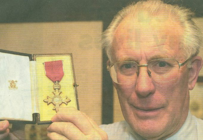 Proud son, David Evans holds up the MBE awarded to his father Bert, a headteacher who realised things were worse than they were led to believe. | Steve O'Connell