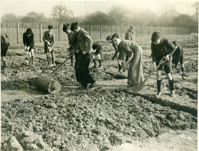 Digging for Victory - During the 2nd World War schools were required to help the war effort. These pupils can be seen preparing the 40 plots required, each measuring 30ft x 10ft. The roller being used by one of the boys was made at the school. | Thundersley Primary School