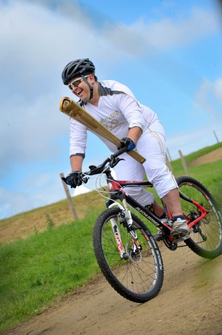 Dan Jarvis carrying the Torch round on a bike | Nick Strugnell