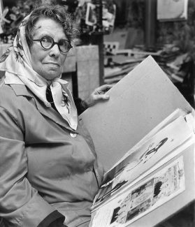 Lucia Boston reviews her cuttings.   With permission of Echo Newspapers Ltd