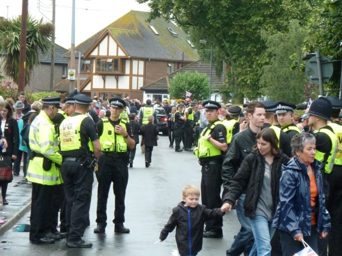 Essex Police (VG) waiting in Chapel Lane for the Olympic Torch to come back from the bike track. | Phil Coley
