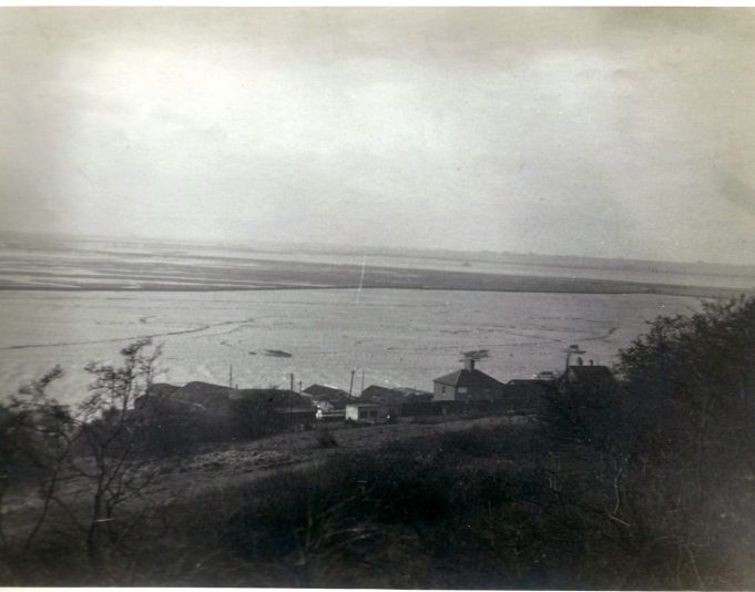 Leigh Building Supply wharf in the foreground, that was in Benfleet Creek, looking towards Pitsea. | Gilbert Wines