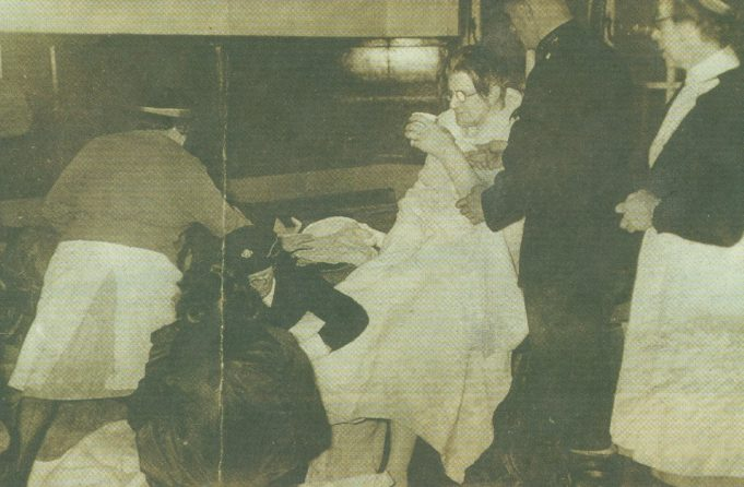 Helping Hands - a freezing cold flood victim is given a hot drink | Echo supplement 29 Jan 2003