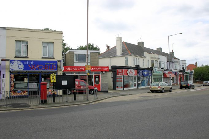 The shop has changed hands once again and where the property was demolished, there now stands a dry cleaners.  This photo taken May 2011   Eileen Gamble