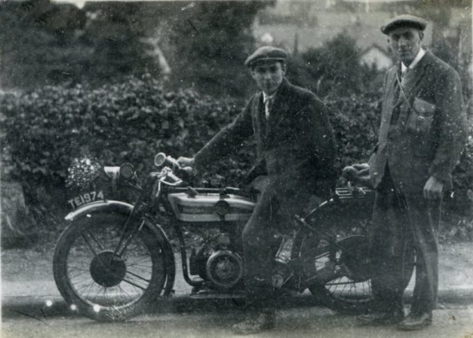 Henry Clubb - Photographer and his son. The motorcycle is a Douglas. c1930