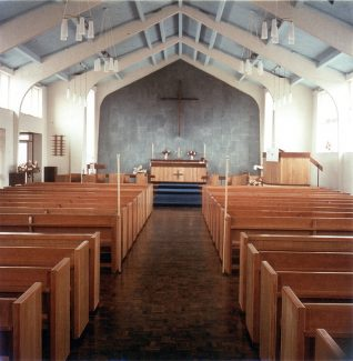 A more recent picture of the interior, however the hand built pews have been replaced with chairs.