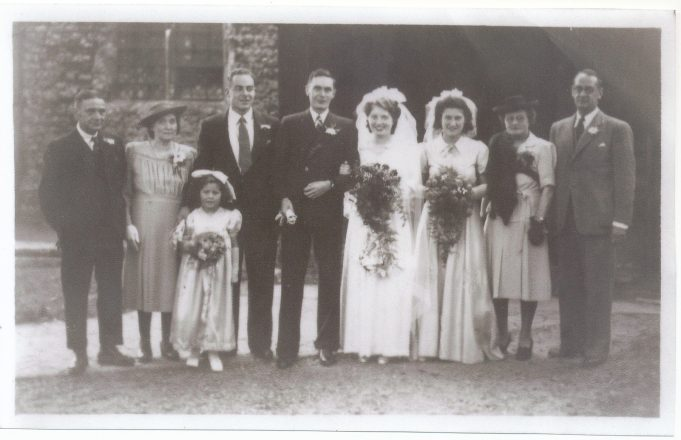 Wedding day - from left to right :Edmund Sugg, Elizabeth Sugg, bridesmaid, Eric Kemp (best man), Ed Sugg, Iris Sugg, Betty Midler, Mrs Knightley, Len Mc Cowell (uncle)