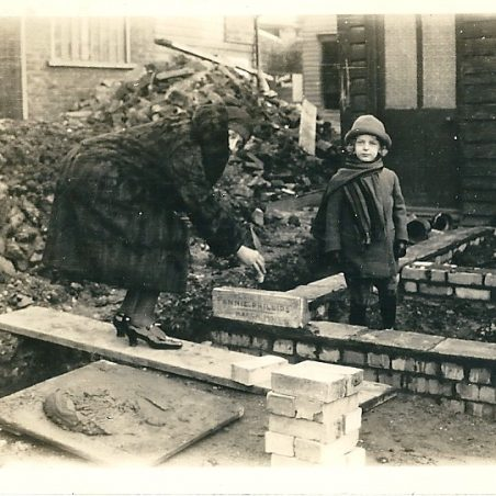 Laying the foundation stone, it is carved with 'Annie Phillips March 1931'.   I have looked for this stone at the rear of The Hoy but it is not visible  there have either been later changes or it has been rendered over. | Joan English