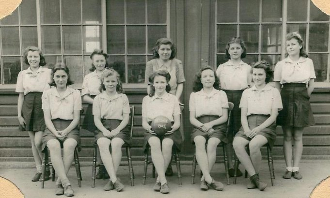 Benfleet School Netball Team 1945.  Miss Bass in centre in back row.  Front row from left to right Joy Eason, in centre Iris Kenny, Vera Winfield. | From the collection of Miss Bass