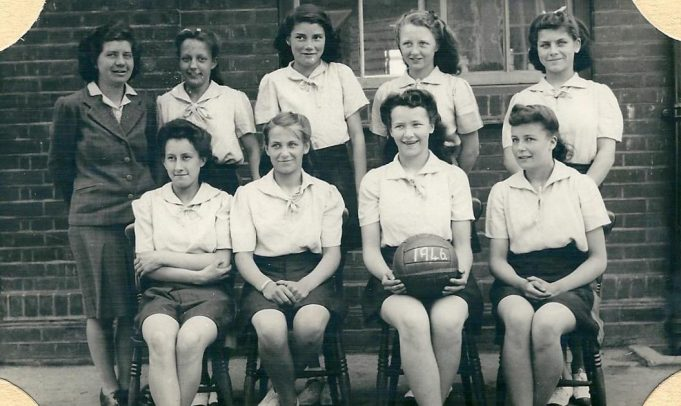 Winners of The Benfleet Shield 1946 (Netball) Rear left to right Miss Bass, Centre Marion Roberts.  Front Row Mirran Bone, Val ? with Ball Iris Kenny, Joy Therlow. | From the collection of Miss Bass