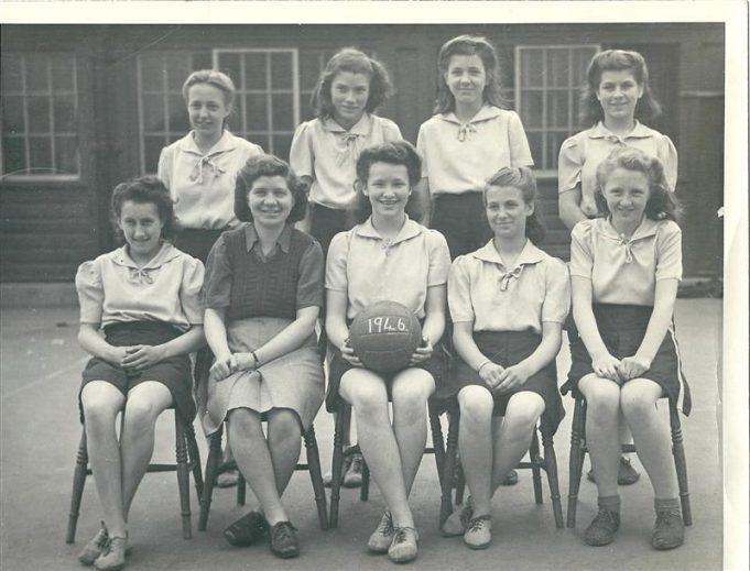 Miss Bass with the netball team 1946. | Miss Bass