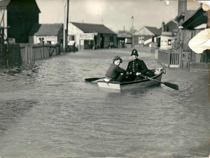 Joan Philips (nee English) one of the crew above  'assisting the law' get about in Benfleet, in the sea rangers dingy.  The boat is in the flooded High Street close to where the taxi rank is now outside the station , at that time it was outside the photographers Shine and Holmes. | Joan English (nee Philips)