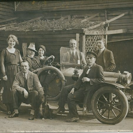 In the rear yard of The Hoy before the renovations in 1930's, the landlord John (Jack) William Phillips at the wheel of his car.  Left to right, rear May Phillips, landlord, wife Annie Phillips, unknown, Harry Phillips.  Front unknown, Wan Harmer | Joan English (nee Phillips)