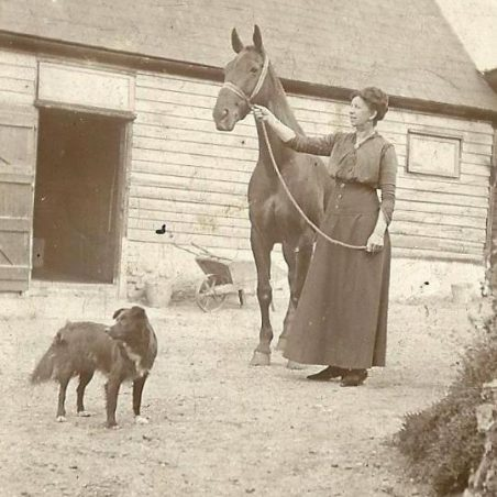 Annie Phillips in The Hoy yard with one of the horses that was kept for hire if someone needed to cross to Canvey Island, around 1930's | Joan English (nee Phillips)