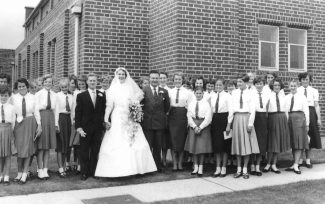 Marriage of Ms McConnell (music teacher). To the right of Ms McConnell is Mr Melvin Beddow (head of the music department). The King John School Choir sang at this wedding in 1958 | Ann Morrison collection