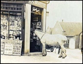 Changing Times - the newsagents corner shop with the club in the background