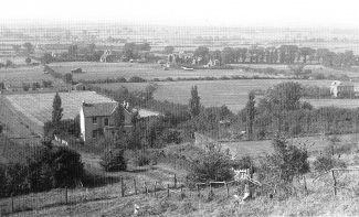 This photo was taken from the area of St Peter's Church looking down towards Chesterfield Avenue. The area beyond the house, which still stands today, is now known as Manor Trading Estate.  Date unknown.