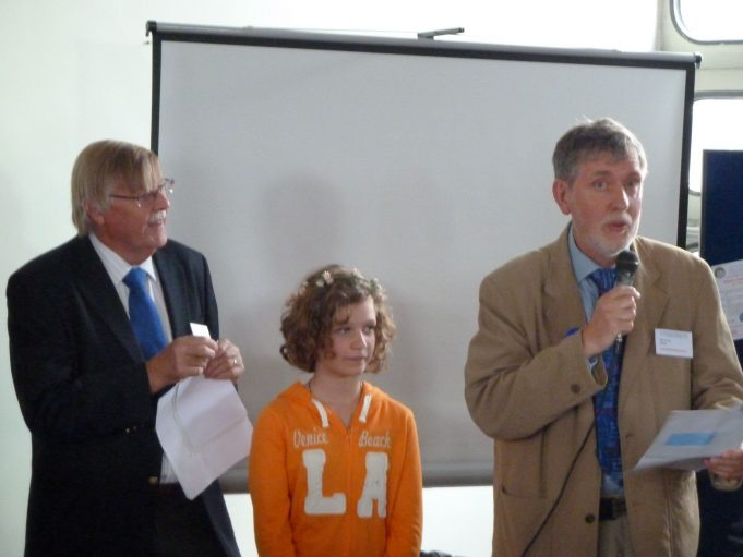 Nick Turner Hadleigh and Thundersley Archive Chairman speaking, with Roy Swanston HLF Representative on the left and Hannah Allwright winner of the photography competition in the middle. | Phil Coley