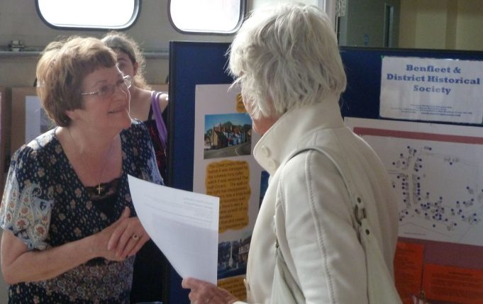 Jackie Terry, Chairman of Benfleet & District Historical Society, talking to a visitor to their stall | Phil Coley