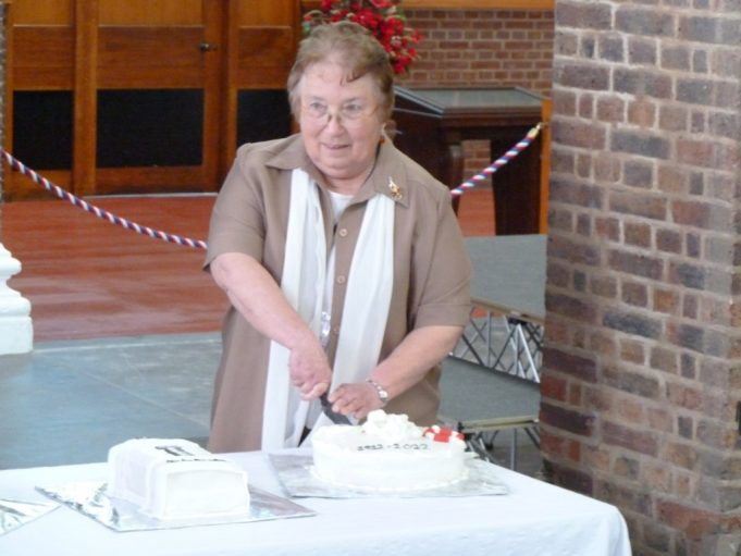The cutting of the Tilbury centenary celebration cake by June Brown   Phil Coley