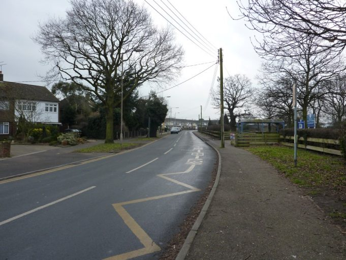 Rushbottom Lane 2015 outside Woodham Ley School, with a similar curve in the road.